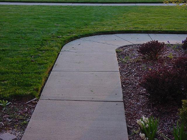 sidewalk driveway edging shawano wi 715 526 7696